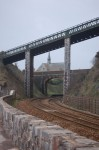 Bridge over the line, station beyond - portrait